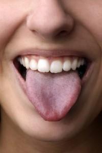 witte of gele aanslag op je tong?